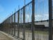 Secure fencing surrounds the Detention Center on Christmas Island, Australia. In 2015 some 150 male asylum seekers to Australia were being held here.