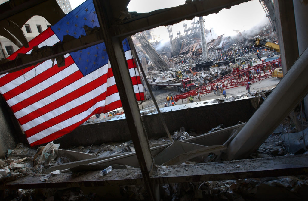 A flag flies in the wreckage of the World Trade Centers, September 15, 2001.